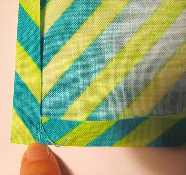 Fold all sides over once and iron